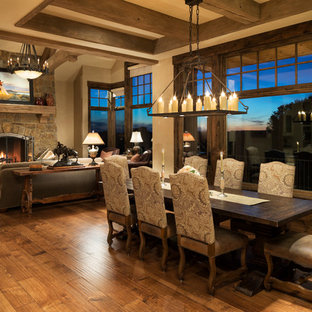 Expansive rustic open plan dining room in Minneapolis with beige walls and medium hardwood flooring.