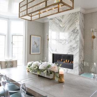 ニューヨークの広いトランジショナルスタイルのおしゃれな独立型ダイニング (メタリックの壁、濃色無垢フローリング、横長型暖炉、石材の暖炉まわり、茶色い床) の写真