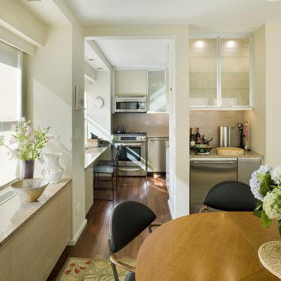 Example of a trendy dark wood floor kitchen/dining room combo design in New York with beige walls