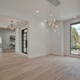 Inspiration for a large transitional medium tone wood floor enclosed dining room remodel in Nashville with white walls and no fireplace