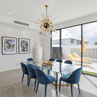 Design ideas for a midcentury separate dining room in Newcastle - Maitland with white walls, concrete floors and grey floor.