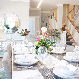 Ispirazione per una grande sala da pranzo aperta verso la cucina moderna con parquet chiaro, pareti grigie, camino sospeso e pavimento beige