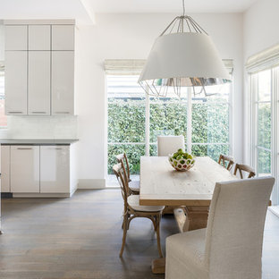 Inspiration for a contemporary dark wood floor and brown floor kitchen/dining room combo remodel in Dallas with white walls