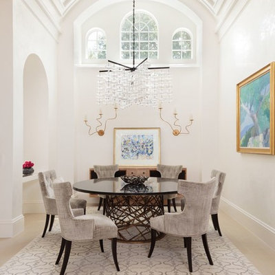Enclosed dining room - large transitional light wood floor enclosed dining room idea in Miami with white walls and no fireplace