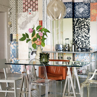 This is an example of a bohemian dining room in London with painted wood flooring.