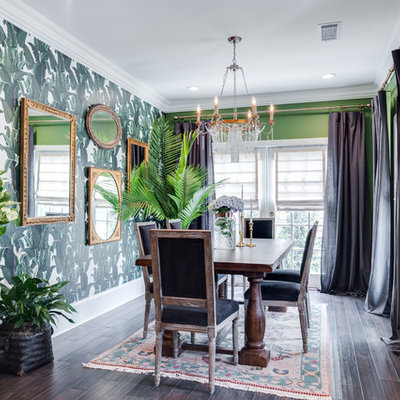 Example of a small eclectic dark wood floor and brown floor enclosed dining room design in Orange County with green walls and no fireplace