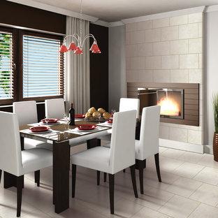 Foto di una grande sala da pranzo design chiusa con pareti nere, pavimento in gres porcellanato, camino classico e cornice del camino piastrellata