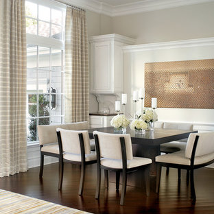 Example of a classic dark wood floor dining room design in New York with beige walls