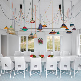 Coastal enclosed dining room in New York with white walls, carpet and multi-coloured floors.