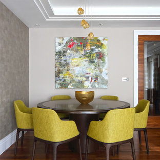 Traditional dining room in London with beige walls and dark hardwood flooring.
