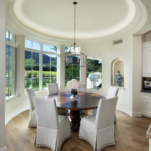 Example of a small tuscan light wood floor kitchen/dining room combo design in Phoenix with beige walls and no fireplace