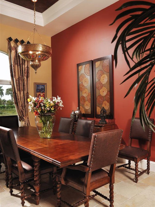 inspiration for a mediterranean dining room remodel in miami with red walls - Dining Room Remodel Ideas