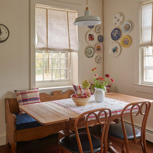Inspiration for a small cottage medium tone wood floor dining room remodel in New York with beige walls and no fireplace