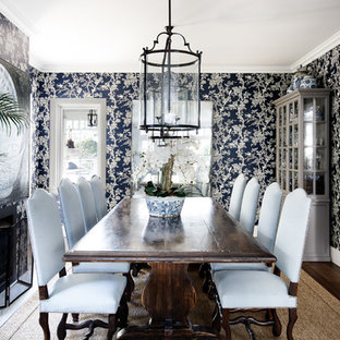 Design ideas for a transitional dining room in Sydney with blue walls and dark hardwood floors.