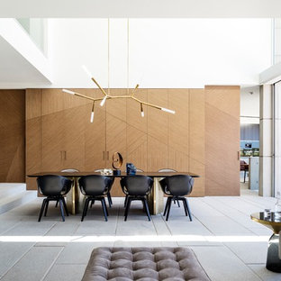 Design ideas for a contemporary dining room in Sydney with brown walls and grey floor.