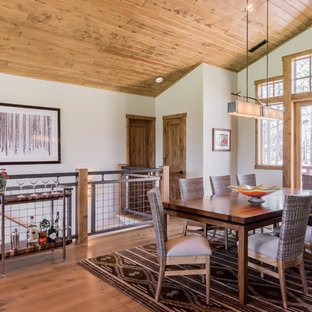 Photo of a rustic open plan dining room in Other with white walls, medium hardwood flooring and brown floors.