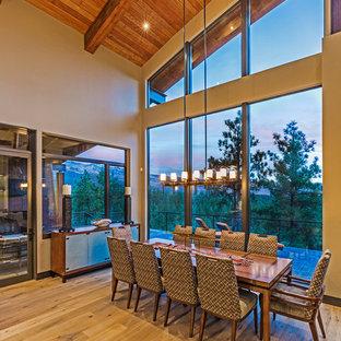 Inspiration for a modern light wood floor kitchen/dining room combo remodel in Denver with beige walls