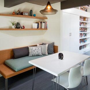 Foto di una sala da pranzo design chiusa e di medie dimensioni con pareti bianche, pavimento in laminato, nessun camino e pavimento grigio