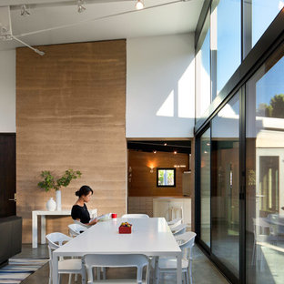Inspiration for a mid-sized contemporary concrete floor great room remodel in San Francisco with no fireplace
