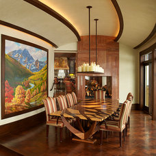 Rustic Dining Room by VAg Inc. Architects and Planners