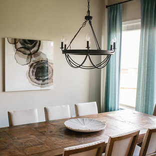 Inspiration for a mid-sized coastal dark wood floor and brown floor enclosed dining room remodel in Austin with beige walls and no fireplace