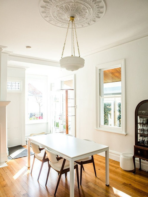 Trendy Medium Tone Wood Floor Dining Room Photo In Sydney With White Walls