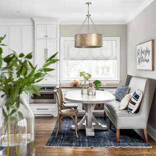 Large transitional medium tone wood floor and brown floor kitchen/dining room combo photo in Chicago with gray walls