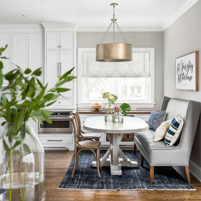 Transitional Dining Room by Designstorms LLC