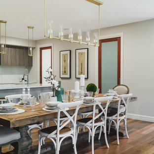 Transitional kitchen/dining combo in Melbourne with beige walls, medium hardwood floors and brown floor.