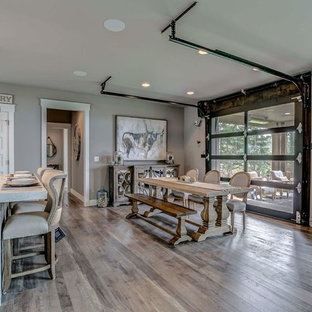 Inspiration for a medium sized farmhouse open plan dining room in Other with grey walls, laminate floors and grey floors.