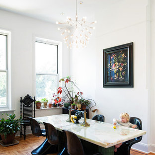 Example of a trendy medium tone wood floor and orange floor dining room design in New York with white walls