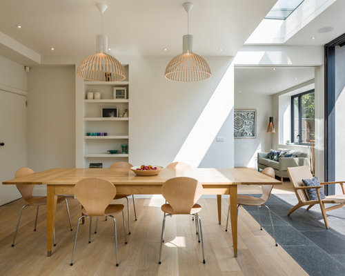 Danish Light Wood Floor Dining Room Photo In London With White Walls