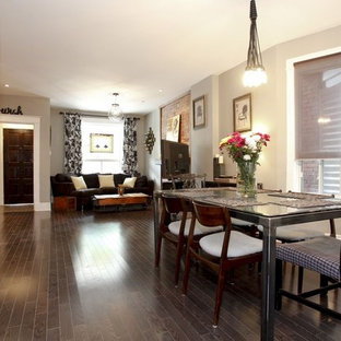 Inspiration for an eclectic dark wood floor dining room remodel in Toronto with gray walls