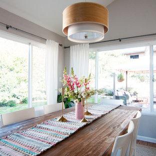Foto de comedor ecléctico, pequeño, abierto, con paredes grises