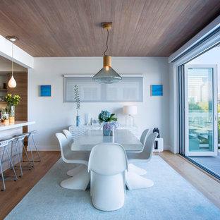 Example of a coastal light wood floor great room design in San Francisco with white walls