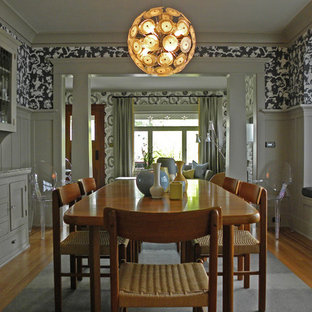 Arts and crafts medium tone wood floor dining room photo in Seattle with multicolored walls