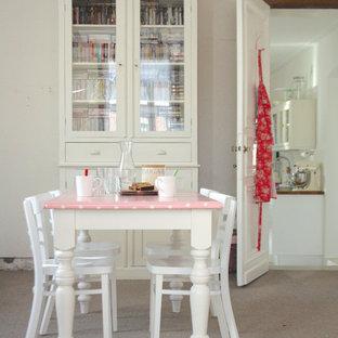 Cette image montre une salle à manger style shabby chic.