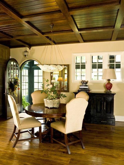 Example Of A Classic Dining Room Design In Chicago With Beige Walls And Dark Hardwood Floors
