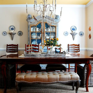 French country medium tone wood floor dining room photo in New York with beige walls