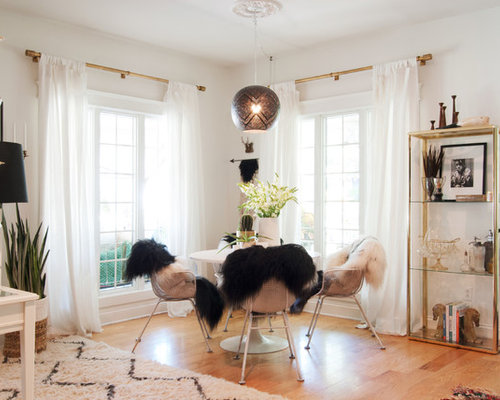 Large eclectic medium tone wood floor great room idea in Cleveland with  white walls - Brass Curtain Rods Houzz