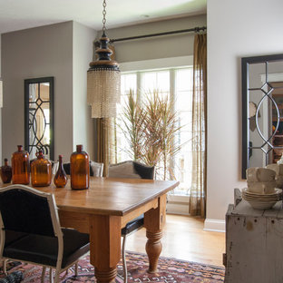 Large eclectic light wood floor enclosed dining room photo in Cleveland with gray walls and no fireplace