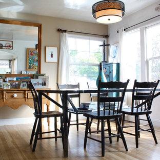 Coastal medium tone wood floor dining room photo in San Francisco with beige walls