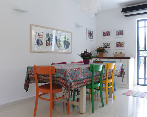 Example Of An Eclectic Dining Room Design In Tel Aviv With White Walls