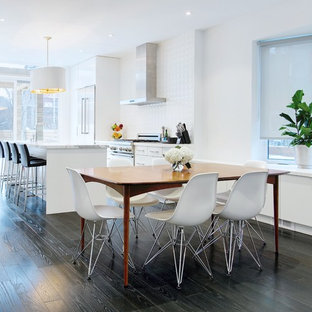 Example of a trendy brown floor great room design in Toronto with white walls
