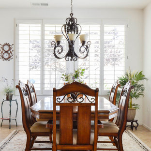 Dining room - mid-sized mediterranean travertine floor dining room idea in Los Angeles with white walls