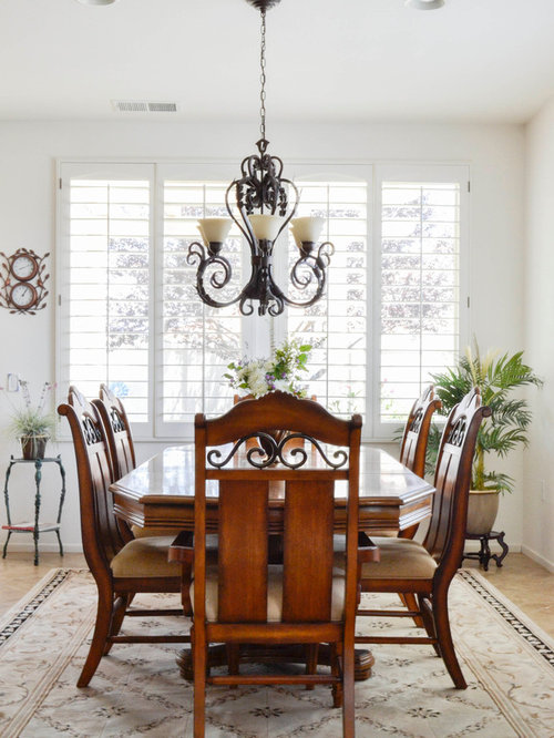 Mid Sized Mediterranean Dining Room In Los Angeles With White Walls And Travertine Floors