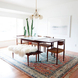 Dining room - mid-sized 1960s light wood floor dining room idea in Denver with white walls and no fireplace