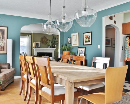 Example Of An Eclectic Dining Room Design In Portland With Blue Walls