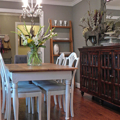 Inspiration for an eclectic dark wood floor dining room remodel in Dallas with gray walls