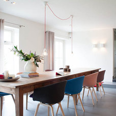 Contemporary Dining Room by Louise de Miranda